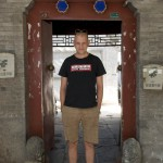 Dominic at the entrance of the hutong where Plastered has its offices.