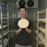 Liu Yang with a tomme in the maturing room.