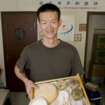 Liu Yang with a selection of his cheese.