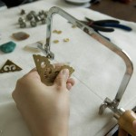Wang Lei in her workshop works on her next nicely made in China piece of jewellery.