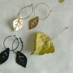 Gold leaf and black leaf earrings of the Silk Road Flowers collection.