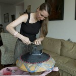 Elisabeth Koch at work on a new creation in her Beijing apartment.