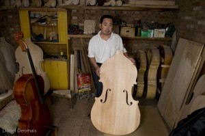 Mr Gao with a Sichuan maple soundboard ready to be mounted.