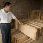 Mr Gao shows his reserve of drying wood.