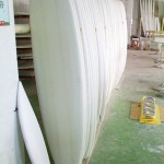 Surfboards blanks in the factory just before being fiber glassed.