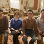 Lisa Minder-Wu owner of The Orchard with her team of carpenters in He Ge Zhuang village.