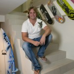 Adam Healy in the Benpat International showroom with skateboards, another type of boards made by Benpat International.