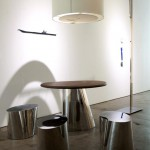 Table, stools and lighting by DESIGN MVW.