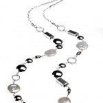 Marion Carsten's mixed elements pearl necklace made of sterling silver, rhodium plated, freshwater pearls, conch shells.