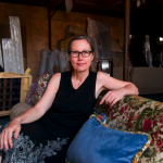 Beijing-based Marianne Friese sitting on a couch she created. Each couch is unique.