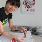 Dong Li Jun (董丽珺) working on the latest delivery of T-shirts in CreativCulture's Beijing offices.