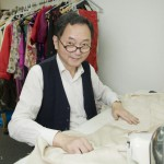 Mr Lau On Hing the qipao maker in his workshop in Lan Kwai Fong in the heart of Hong Kong island.