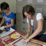 Bella (L) and Annalisa (R) select the rice bags that will end up being stitched together to make Bez & Oho handbags.