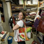 Annalisa, Bez & Oho's owner, in her studio showing one of her latest handbags.