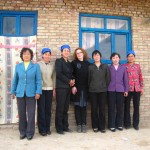 "Amélie Peraud, Tang'Roulou founder with the women of the ""Baihua"" cooperative who make handmade embroidery."