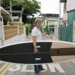 Adam Healy, Ark Surfboards founder, with a standup paddle board in Hong Kong.