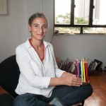 Italian designer and Sand's founder Silvia Marlia designs furniture for children. She's holding the pencil tray, one of her creations, that helps keep some order on your child's desk.