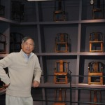 Mr Kele Ma photographed in his museum in Tianjin, in front of chairs from Song, Yuan, Ming and Qing dynasties.